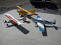 Name: Side of 3 planes.jpg Views: 650 Size: 106.7 KB Description: A day at the field.  Superstar 40 trainer, Seagull Extra300S and CMP Cub.