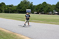 Name: RC Flying 9-3-11 007.jpg Views: 45 Size: 298.3 KB Description: Joey prepping his plane for takeoff.