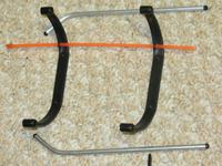 Name: IMG_0770.jpg Views: 154 Size: 97.4 KB Description: Struts and skids with the orange antenna cover.