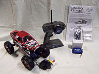 Name: Losi Rockcrawler.jpg Views: 88 Size: 81.1 KB Description: Truck comes with everything pictured. -Truck -2.4gHz TX -Lipo Battery and Charger -Stock NiMh Battery and Charger -All the paperwork, instructions and spare parts that came with truck when purchased.