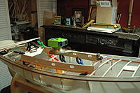Name: SA sailboats 011.jpg Views: 11 Size: 2.93 MB Description: Installing upper cabin framing and beams. Sitting on the desk are 2 ships wheels. 1 on a pencil sharpener and the 8 spoke one on a cigarette lighter. both the correct size for the models.