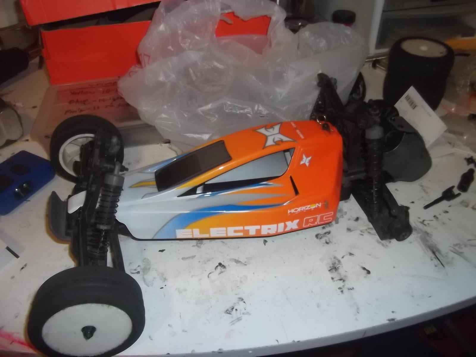 Name: DSCF1962.jpg Views: 214 Size: 124.6 KB Description: The car on the workbench