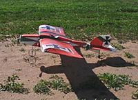 Name: #0 H-b. 2010-Mar-05 SS-Lit Cigar-r-g backgrnd green field.jpg Views: 179 Size: 77.9 KB Description: