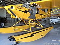 Name: Cub with floats on land in hangar.JPG