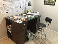My work space is a desk with glass. The plans on the wall are for the Ford Flivver I build in winter 2018.