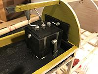 Name: F39CA6B2-AF6A-4307-B42D-02B20E3D7032.jpeg Views: 4 Size: 2.13 MB Description: The radio is in place. Balsa box, paint, and wire. The round pieces on top of the box and the mast audio brace hanging down were cut from the shaft of a flag.