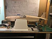 Name: Cowl in place on plane.jpg Views: 10 Size: 625.0 KB Description: Finished cowl held in place with magnets. You can see my plans on the wall and on the building bench. And yes, my fancy white plane holder is a $1 styrofoam cooler with gorilla tape keeping cut edges from flaking. Making process!