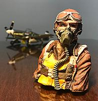 Name: 5 Final with plane.jpg Views: 7 Size: 455.1 KB Description: Aces of Iron one-seventh scale WW2 Pilot. Painted and then sealed with Kyrlon Matte Finish spray paint. In the background is a one-48th scale plastic model.