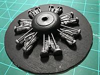 Spray painted flat black then used dry brushed silver, dragging a barely wet brush against the cylinders.   Then added metal rods.