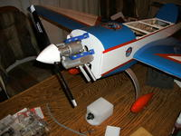 Name: GEDC0330.jpg Views: 629 Size: 101.3 KB Description: A very basic/stock setup with all off-the-shelf stuff: GMS .76, Bisson Pitts muffler, stock fuel tank, Great Planes easy fueler in cowl.