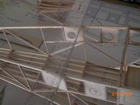 Name: AIRPLANE 066.jpg Views: 120 Size: 60.0 KB Description: I laid a straight each across the fuselage to mark where the vertical sticks are so to glue the formers exactly where they are suppose to go. Eyeballing is not good enough for me.