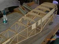 Name: AIRPLANE 072.jpg Views: 113 Size: 69.8 KB Description: 3/4 right rear view. All top formers glued in place. Ready for stringer installation.