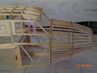 Name: AIRPLANE 076.jpg Views: 153 Size: 50.9 KB Description: F8 and all 7x F9 installed and glued in place. F9 were aligned with each stringers so some were radially glued with respect to thrust line of the fuselage. The nose structure gets glued to the fuselage.It begining to look like the real thing.