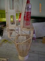 Name: AIRPLANE 078.jpg Views: 114 Size: 55.8 KB Description: Epoxy bottles added to put some weight while glue dries.