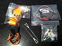 Name: photo8.jpg Views: 163 Size: 174.8 KB Description: All you need, 2 servos, 1 Y-Lead, 1 Servo Reverser, the Spare Horns and Clevis in your kit. If you dont want to make your Pushrods from scratch buy the ones pictured, (details in earlier post.)