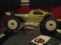 Name: IMGA0084.jpg Views: 62 Size: 119.3 KB Description: The truggy with its white racing wheels on