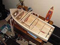 Name: P1140330.jpg Views: 295 Size: 295.4 KB Description: Hull complete, prop shaft fitted, cabin frame up, and the front compartment cut and fitted. So far I am happy with my work