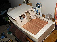 Name: P1140374.jpg Views: 266 Size: 224.8 KB Description: planked the door, will scribe the cabin once 2nd window is cut. waiting on sizes/windows. the last pieces to stick onto the cabin will be the wooden frames. Will do that once its painted.