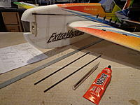 Name: DSC00211.jpg Views: 357 Size: 255.4 KB Description: Step 28a - Locate the two lower carbon rods for the lower fuselage. Lightly sand and wipe clean.