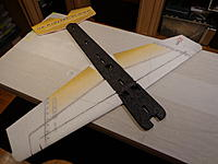 Name: DSC02665.jpg Views: 790 Size: 152.6 KB Description: Insert the wood spar - Insert the bottom rod - Flip over and insert the top rod - Medium CA in the center wood spar section - Thin CA every where else. Do this on a flat table and make sure the wing is flat