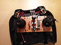 Name: 20121027_184511.jpg Views: 92 Size: 191.7 KB Description: Take off the cover and remove screws holding on board, then turn board over.