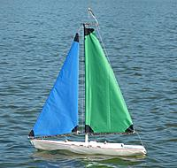 "Name: Nir-11-24-12-44.jpg Views: 46 Size: 58.9 KB Description: Nylon storm sails, 20% sail area reduction, mast 36"" instead of stock 48"".  Sheeting stock; stays similar."