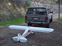 Name: 100_5728sm.jpg Views: 160 Size: 206.5 KB Description: The plane when I first got it trying to figure out if I could transport it!  It did, but unfortunately the Jeep is history!