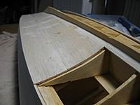 Name: port side bottom sheeting 091411.jpg Views: 392 Size: 277.6 KB Description: Port side bottom sheeting and the first bow plank installed