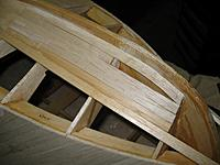 Name: lower bow planking without filler 103111.jpg Views: 313 Size: 134.2 KB Description: Port bow with partial filler installed.  You can see the sistered frame to support the rear of the front filler piece