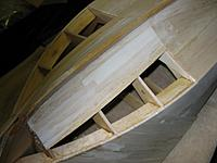 Name: lower bow planking after fitting with light skim coat of hobbylite 103111.jpg Views: 340 Size: 245.2 KB Description: Starboard bow with filler installed and shaped.  Scratch coat of Hobbylite applied just to get an idea of how it will look