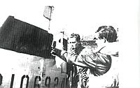 Name: Ralph Hofer with shot up tail 001.jpg Views: 144 Size: 110.1 KB Description: Hofer with QP-L rudder shot out.  He victory rolled this plane in this condition. Clearly breaking the cardinal rule.
