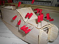Name: SANY1382.jpg Views: 69 Size: 171.0 KB Description: Parts F9 and F10 are installed.  Rubber bands are applying pressure to the fuselage sides and former F5.