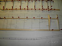 Name: SANY1443.jpg Views: 65 Size: 120.9 KB Description: Don't glue ribs in place yet, just get the bottom skin of the trailing edge aligned using the ribs as they will be installed.