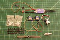 Name: IMG_3205.jpg Views: 594 Size: 97.1 KB Description: All the needed Electronics = 20-30amp Esc, HXT 24 gram 3000kv outrunner, (2)HXT500 5 gram servos, 4.74x4.75 prop + Prop adapter