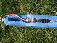 Name: QPlane 9-08 020.jpg Views: 496 Size: 226.1 KB Description: This fuse is also a solid block of 1.9lb EPP.  Note the short receiver antenna.  I really like the SPK 6100e receiver design.