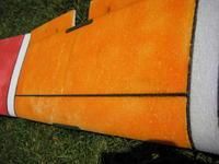 Name: QPlane 9-08 026.jpg Views: 333 Size: 89.3 KB Description: Closer view of the carbon tube.  I often try to hid the tube in the color scheme of the plane.  I put the tubes close to CG.