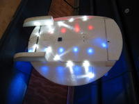 Name: lights on Snowball 11-08 003.jpg Views: 165 Size: 50.9 KB Description: This is the bottom.  the Red and blue lights you see are shining through the EPP wings.  Only the Wite LEDs are on the bottom.