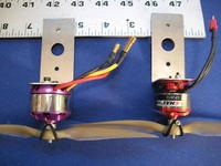 Name: IMG_3210.jpg Views: 863 Size: 92.1 KB Description: This is a comparison in size between the two motors.  The larger motor is about double the smaller in weight amps and thrust.