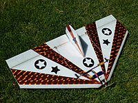 """Name: P1000194.jpg Views: 241 Size: 315.4 KB Description: The CG is back 7.5"""" back on the full span 36"""" Roswell.  This plane flies great and glides great.  The motor is set back 2"""" to protect the motor.  The laminate makes the plane strong enough for combat."""