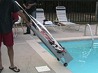 Name: Boat Dolly 2.jpg Views: 456 Size: 240.1 KB Description: Roll up and out of the water.