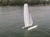 Name: First Sail on Lake.jpg Views: 340 Size: 251.3 KB Description: I finally have a chance to sail the new wingsail on the lake. It tacked well with the new jib installed.