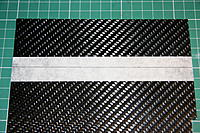 Name: IMG_5503.JPG Views: 216 Size: 384.2 KB Description: 1mm carbon sheet for centre plates. Mask and carefully mark out. Cut out 2 x 50x50mm plates.