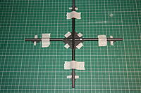 Name: IMG_5519.JPG Views: 362 Size: 336.5 KB Description: Apply a little epoxy to the notches and carefully place the tubes in position. Tape the tubes down, double, triple check the aligment.