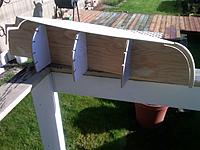 Name: IMG00078-20111103-1151.jpg Views: 125 Size: 199.8 KB Description: bow stem (with rabbit peices), stern post and bottom plank about to be affixed to the form...