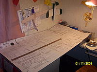 Name: Rascal build log 001.jpg Views: 116 Size: 211.0 KB Description: plans cut out and taped