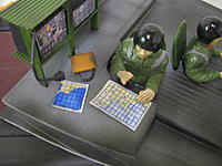 Name: IMG_1404.jpg Views: 172 Size: 156.2 KB Description: Nav pouring over his charts with his attache case near
