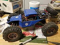 Name: Feiyue FY-03 Desert Eagle.jpg Views: 13 Size: 3.55 MB Description: 1:12 Feiyue FY-03 Desert Eagle 4WD with brushed motor. It tops out at about 35MPH MAX, which is by far the fastest surface vehicle I have and that's good enough for me.