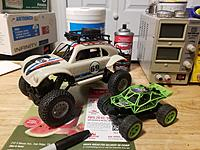 Name: Naughty cat chase toys.jpg Views: 13 Size: 3.50 MB Description: Miscellaneous little R/C toys, which I like to chase my GF's cats with. The little green BRUSHLESS 2.4GHz RTF buggy with white LED headlamps does a great job of going under beds for terrorizing them in very close quarters in classic Kung-Fu fashion.