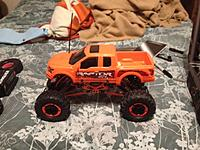 Name: New body and tires.jpg Views: 5 Size: 93.4 KB Description: New Ford Raptor body and more aggressive tires. The body was actually robbed from a Walmart special....it was a New Bright Ford Raptor with burned out steering and the body was salvaged for future projects. I guess it found a great new home and purpose!