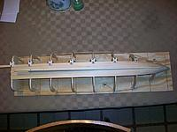 Name: lob. boat #2 007.jpg Views: 125 Size: 255.3 KB Description: First 3 planks installed showing planking clamps.